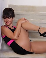Naughty American Gina masturbating on the staircase